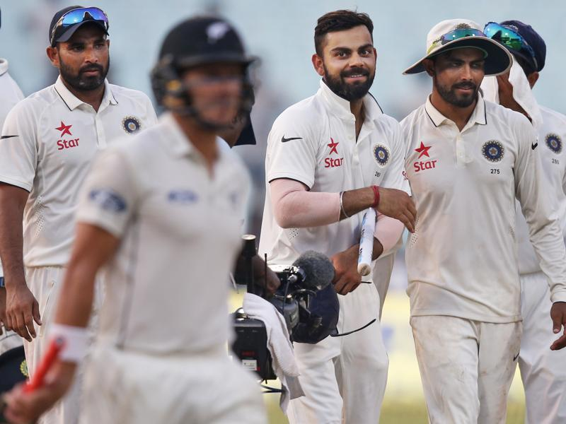 Indian cricket team captain Virat Kohli, third right, and teammates return to the pavilion. (AP Photo)