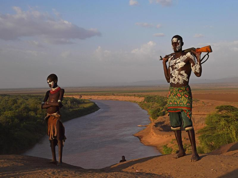 Members from the Karo tribe pose in front of the Omo river on September 23, 2016. The Karo are a Nilotic ethnic group in Ethiopia famous for their body painting.   (AFP)