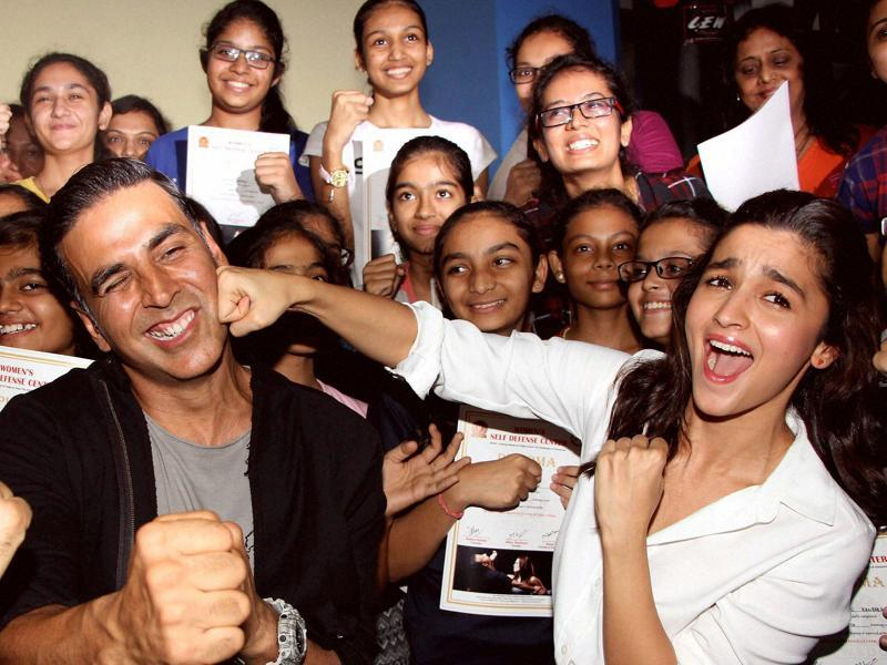 Bollywood actors Akshay Kumar and Alia Bhatt during the graduation day ceremony of women self defense center in Mumbai. (PTI Photo)