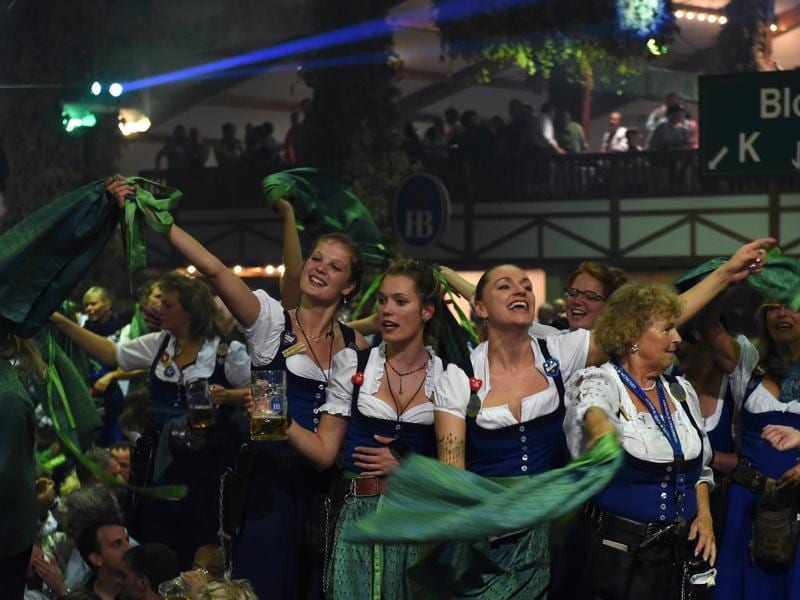 Waitresses celebrate the end of the 183th Oktoberfest on a table in a festival tent of the beer festival in Munich, southern Germany. (AFP)