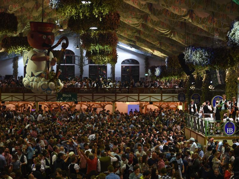Visitors celebrate inside a festival tent on the final night of the 183th Oktoberfest in Munich. (AFP)