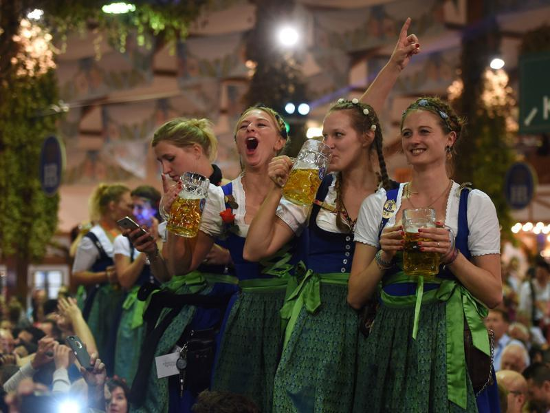 Waitresses celebrate the end of the 183th Oktoberfest on a table in a festival tent of the beer festival in Munich. (AFP)