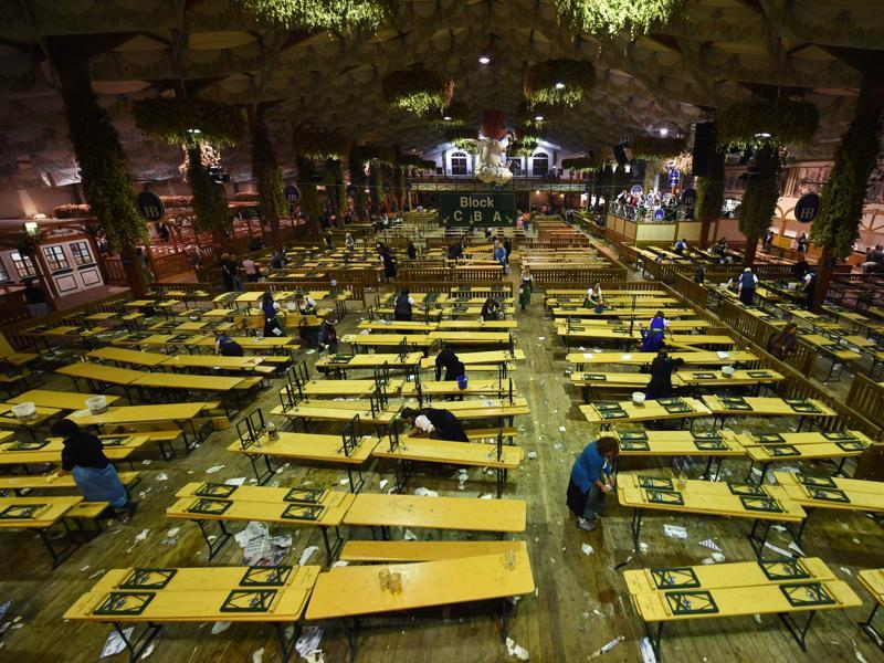 Employees clean up inside an empty festival tent after the end of the 183th Oktoberfest. (AFP)