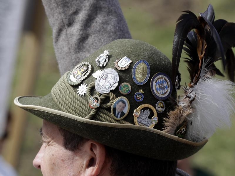 A Bavarian man wearing a hat as rifleman fire their muzzle loaders in front of the Bavaria statue on the last day at the 183rd Oktoberfest beer festival in Munich. (AP)
