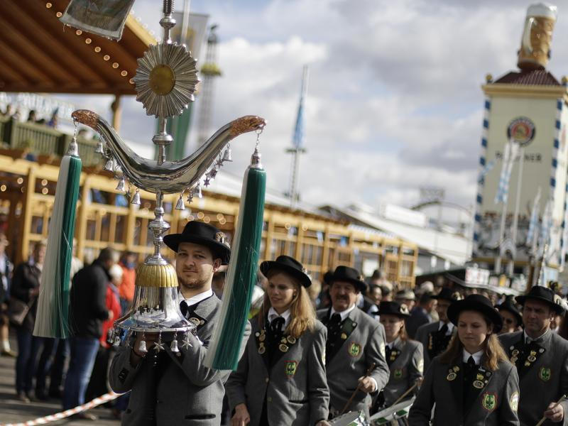 Bavarian musicians in traditional costumes arrive at the Bavaria statue on the last day at the 183rd Oktoberfest beer festival in Munich. (AP)