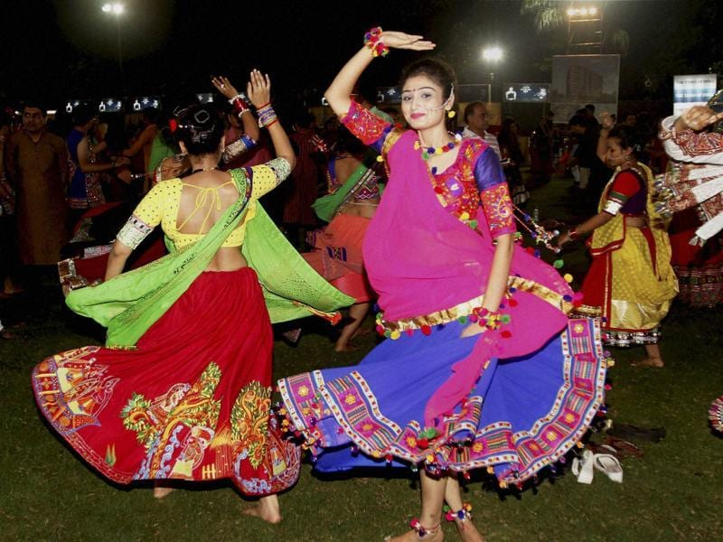Artists perform Garba on the second day of Navratri, in Ahmedabad on Monday.  (PTI)