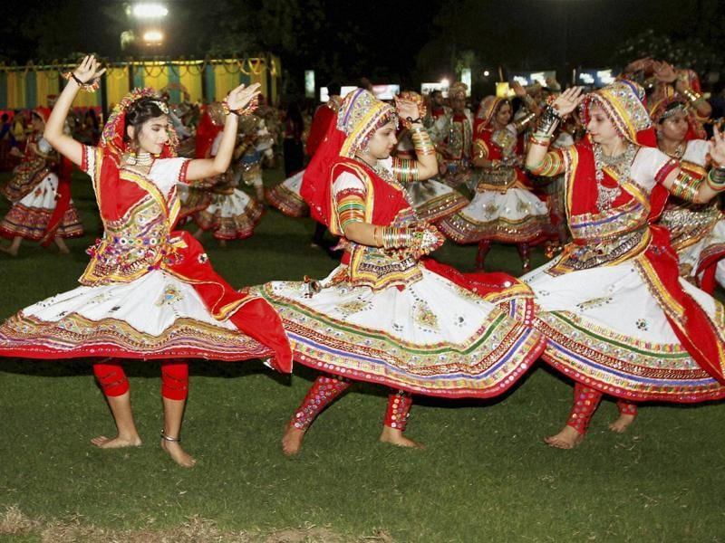 Participants dressed in traditional attire perform Garba on the first day of Navratri festival in Ahmedabad on Saturday night.  (PTI)