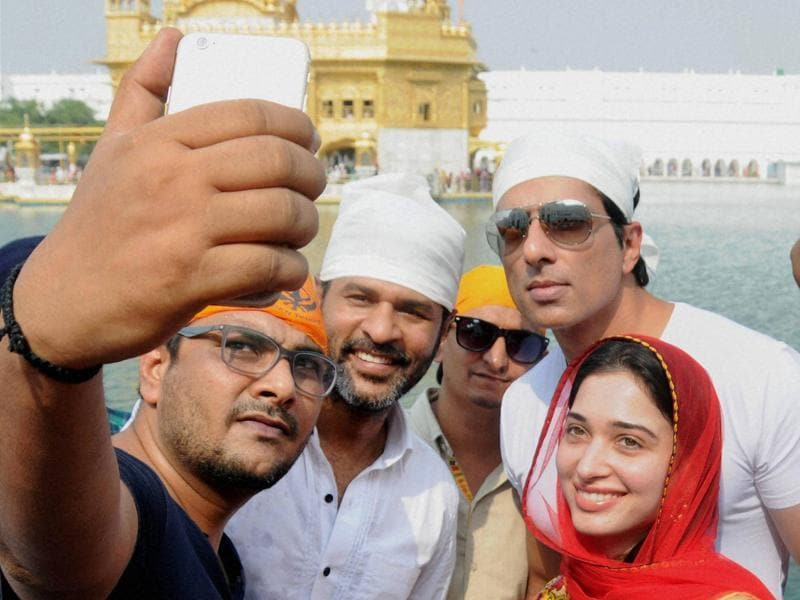 A fan clicks a selfie with Bollywood actors Sonu Sood, Tamannaah and Prabhu Deva during the promotion of their upcoming movie Tutak Tutak Tutiya at Golden Temple in Amritsar. (PTI Photo)