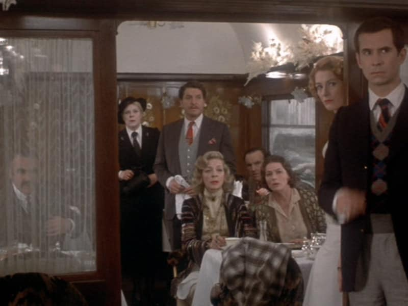 Murder on the Orient Express (1974) - In 1935, when his train is stopped by deep snow, detective Hercule Poirot is called on to solve a murder that occurred in his car the night before. (IMDb)