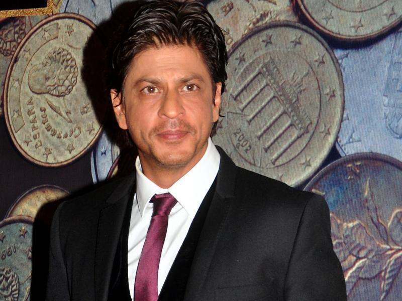 Shah Rukh Khan poses for a photograph during the NRI of the Year Awards ceremony in Mumbai. (AFP Photo)