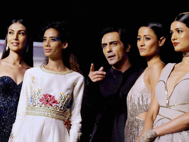 Arjun Rampal with models during the unveiling of Reflections of Style at the preview of Blenders Pride Fashion Tour in Mumbai. (PTI Photo)