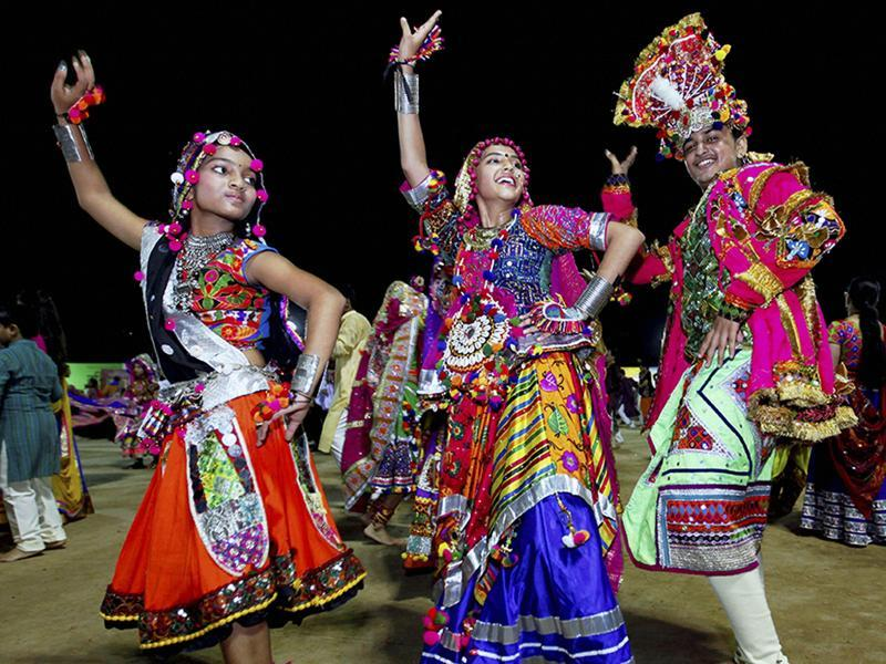 Colourful Gujarati dresses, clicking dandiya sticks, loud garba music, and grounds filled with happy faces and excited chatter between dance breaks: Navatri celebrations this year have been no different, only a lot more fun-filled. (PTI)