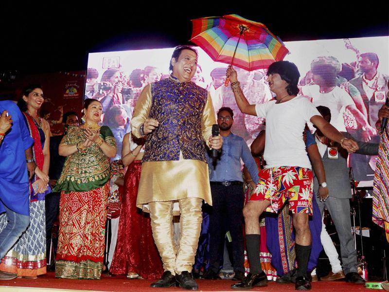 Govinda and his wife at a Garba function on the fourth day of the Navratri festival in Ahmedabad . (PTI Photo)