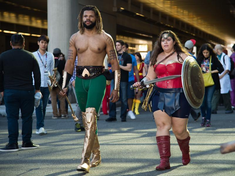 Attendees dressed as superheroes Aquaman and Wonder Woman. (Charles Sykes/Invision/AP)