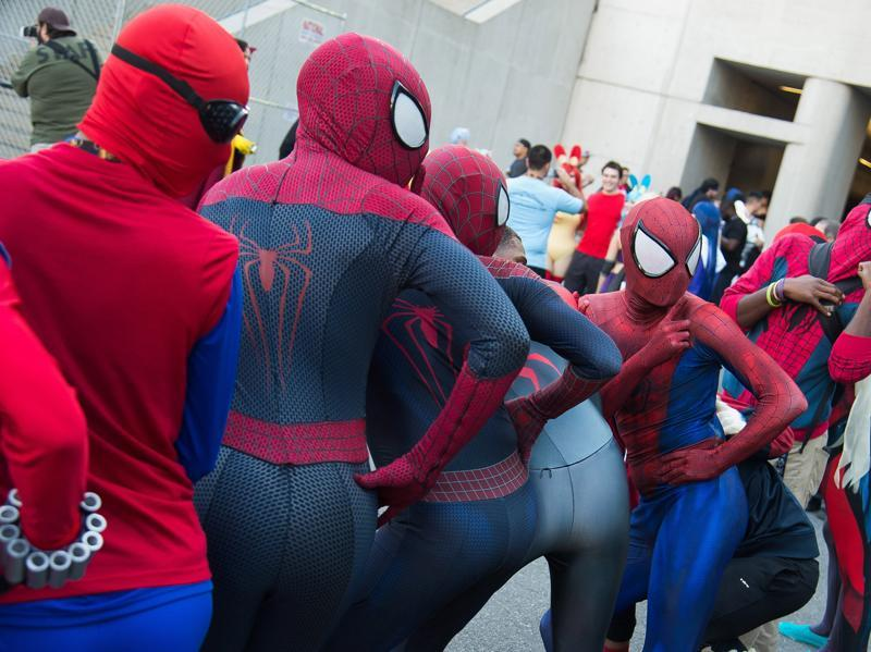 Ooh Spidey! Fans of Spider-Man showing off their best side. (Charles Sykes/Invision/AP)