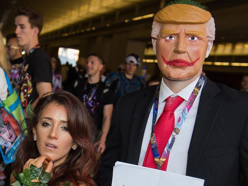 Attendees dressed as a Poison Ivy and Joker Donald Trump. His placard read 'Make America Smile Again'. (Charles Sykes/Invision/AP)