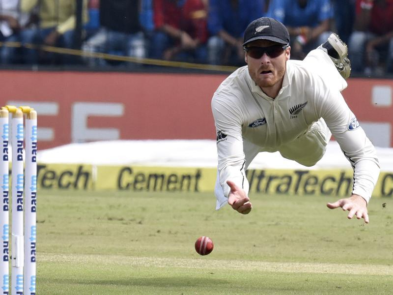 New Zealand cricketer Martin Guptill dives for the ball during the 3rd Test match between India and New Zealand at Holkar Stadium in Indore, on October 8, 2016. (Anshuman Poyrekar / HT PHOTO)