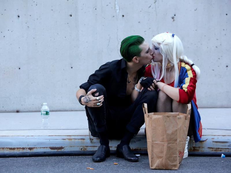 William S Hopkins, dressed as The Joker, kisses Gertrude Grussinger, dressed as Harley Quinn. (REUTERS)
