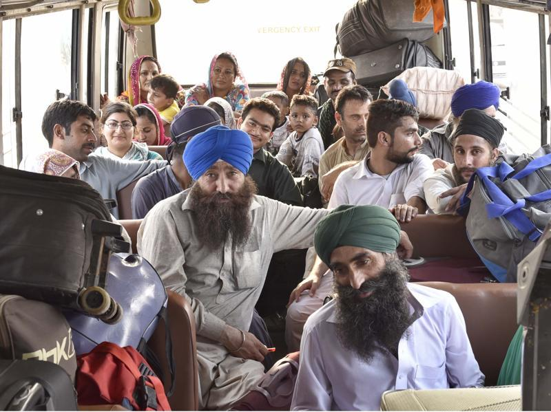 Pakistani Jatha members on a bus at Attari boarder, on October 3, 2016. Tensions between India and Pakistan have made life along the Line of Control hard, especially following an increase in infiltration bids. (Gurpreet Singh / Hindustan Times)