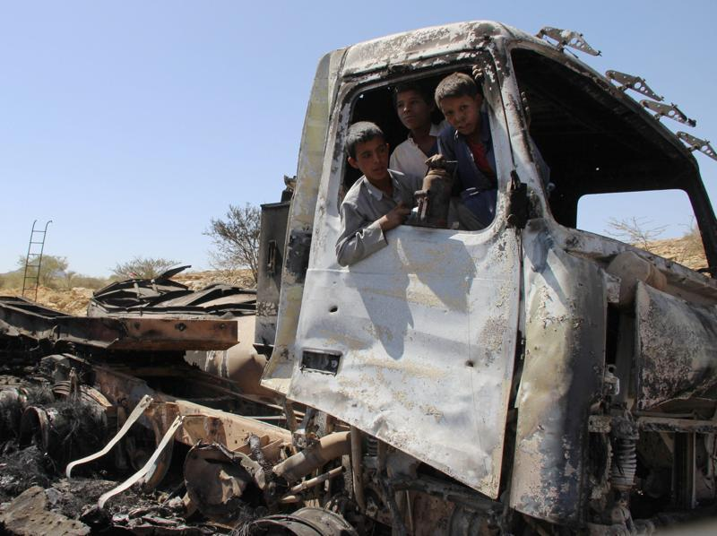Boys play in an bombed out, abandoned oil tanker truck, a day after it was hit by a Saudi-led air strike near the northwester city of Saada, Yemen, on October 8, 2016.  Hundreds have died in the air strikes. (REUTERS)