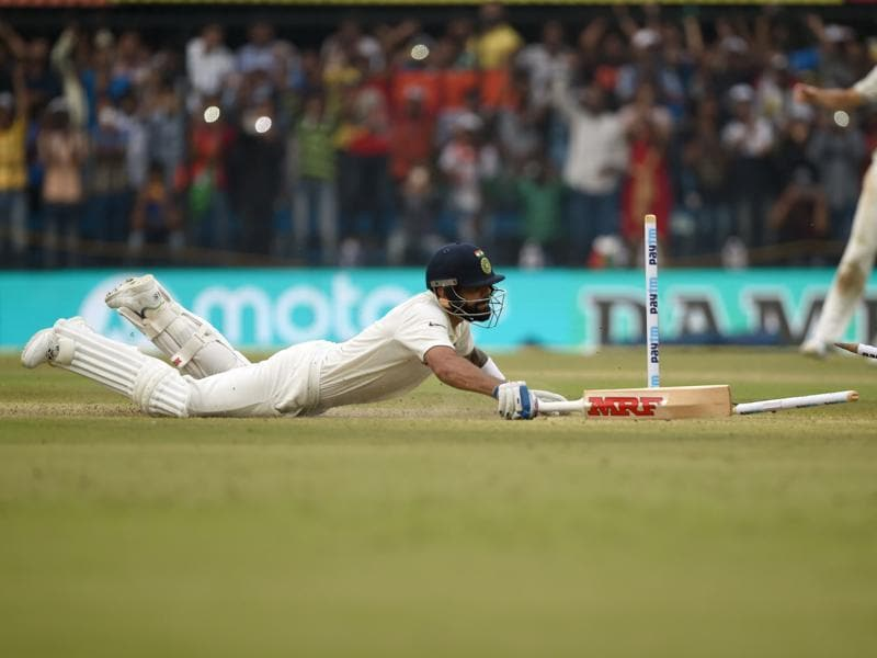 On 99, Kohli had to put in a desperate dive to avoid getting run out. (AFP)
