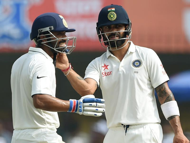Kohli (R) fixes Rahane's helmet during a break. (AFP)