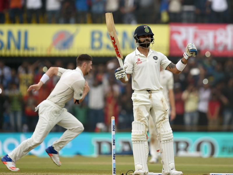 Virat Kohli celebrates reaching 100 on Saturday, his first Test ton at home since 2013. (AFP)