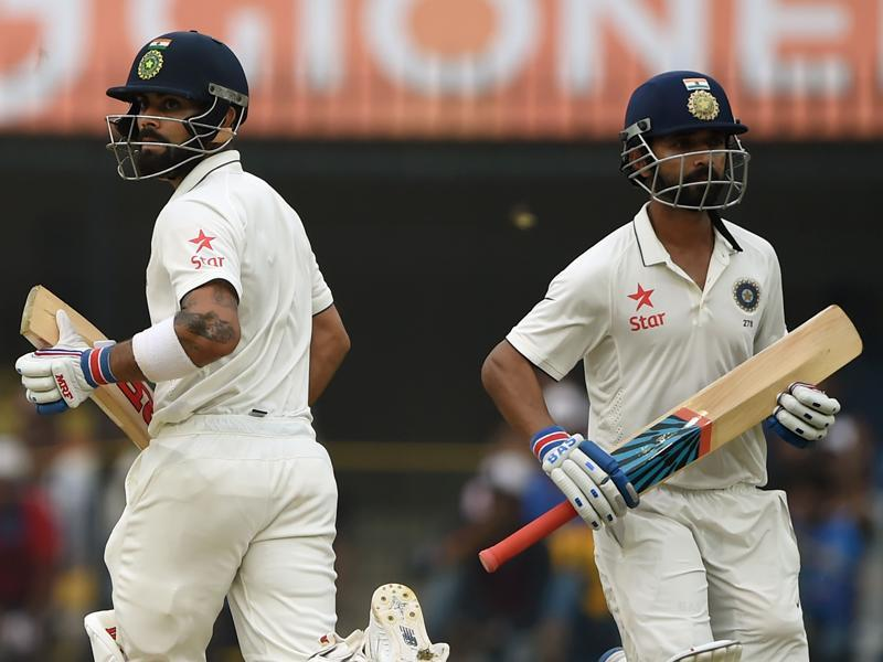 Rahane, left, and Kohli run between the wickets. (AFP)