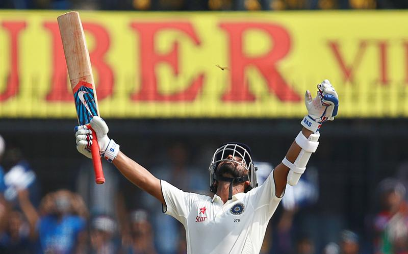 Rahane looks to the heavens in celebration after completing his eighth Test ton. (REUTERS)