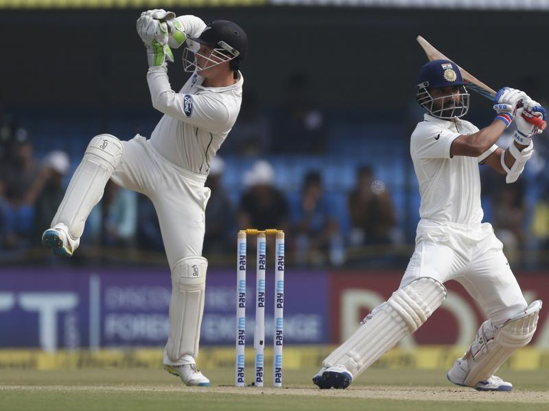 Rahane rocks off the backfoot to hit a shot as New Zealand wicketkeeper Bradley Watling follows the ball. (AP)