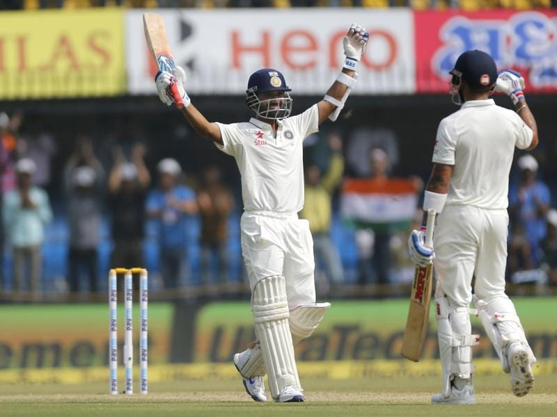 Indian batsman Ajinkya Rahane, left, celebrates his century with team captain Virat Kohli on the second day of the third Test match against New Zealand in Indore on October 9, 2016. (AP)