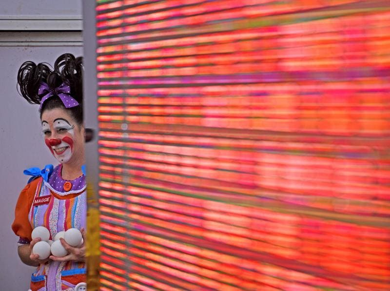 Maggie the clown watches the show backstage at the fifth edition of the International Clown Festival at High Street Phoenix in Lower Parel on Saturday. (Pratik Chorge/HT)