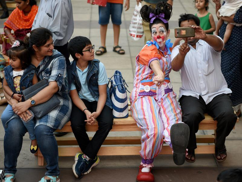 Maggie the clown poses for photos with the audience.  (Pratik Chorge/HT )