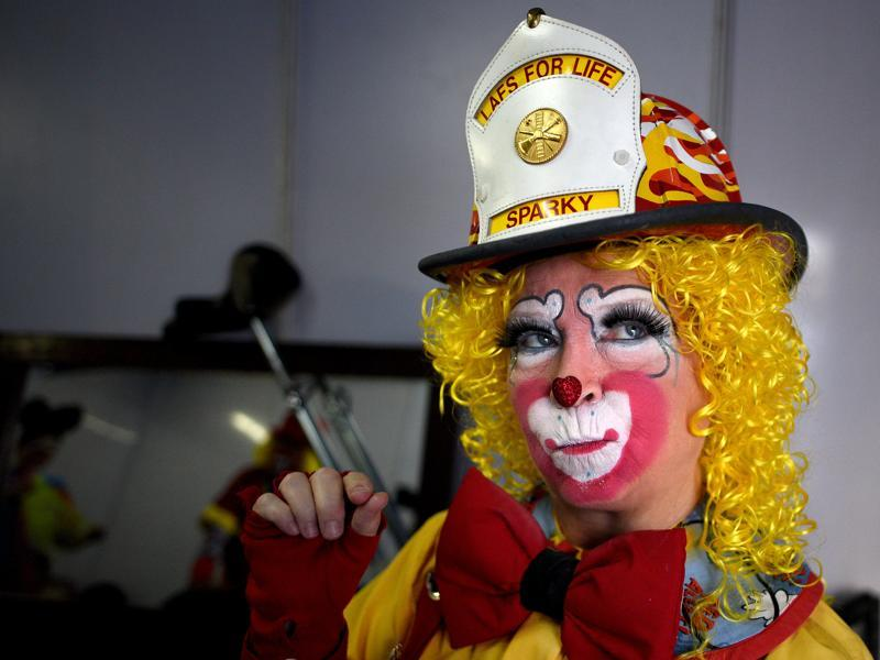 Sparky the clown getting ready inside a makeup room at High Street Phoenix in Lower Parel on Saturday. Sparky is preparing to entertain kids as well as adults on the occasion of the fifth edition of the International Clown Festival. (Pratik Chorge/HT )