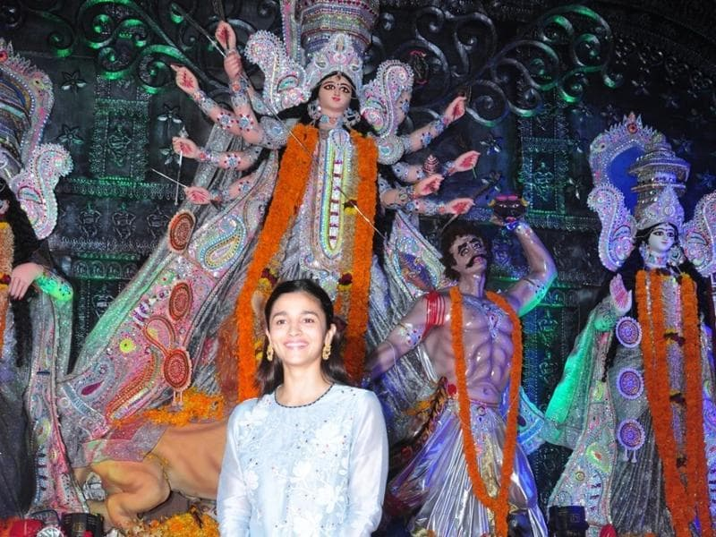 Alia Bhatt during North Bombay Durga Puja celebrations. She posed in front of a massive Durga idol for the camera. (IANS)