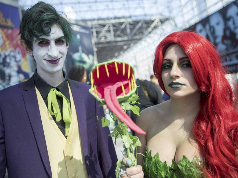 Michael Blaze, left, as the Joker and Kira Scarlett as Poison Ivy pose for a photo during Comic Con, Friday in New York.  (AP)