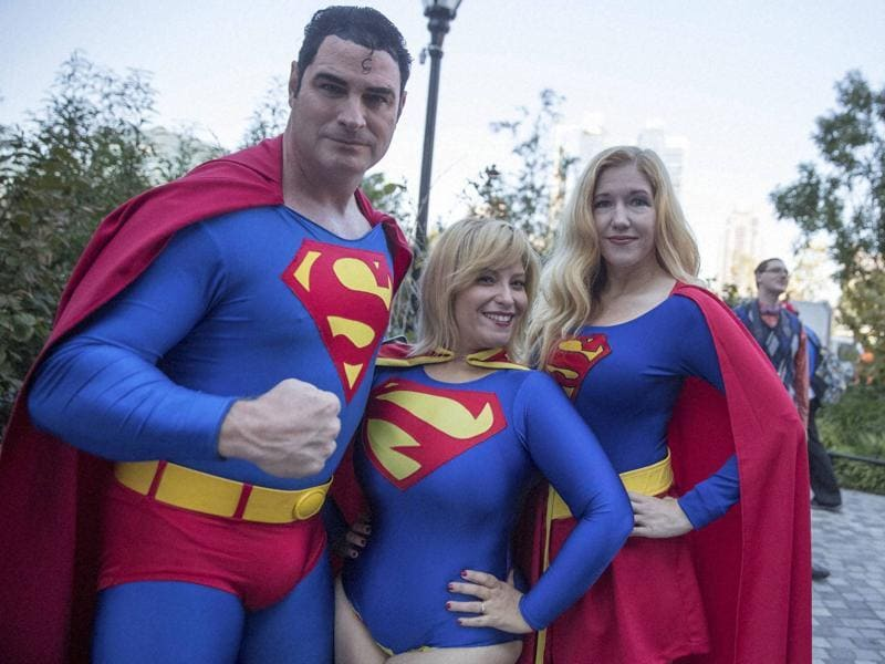 Superman fans Michael Byrnes, left, Frances Tirado, centre, and Amy Byrnes pose for a photo on their way to Comic Con in New York. Comic Con runs through October 9. (AP)