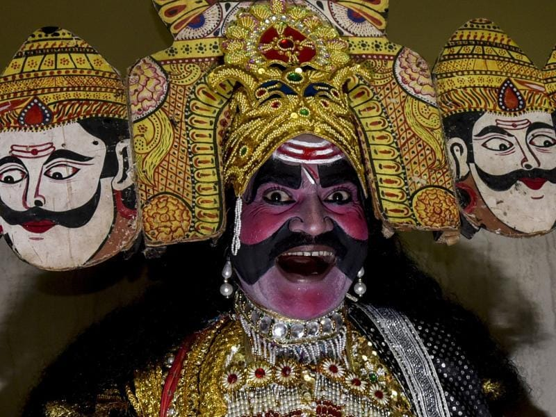 Ashok Kumar Dixit, dressed as Ravana, laughs during a religious procession. (Kunal Patil/HT Photo)