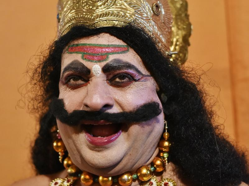 Pradeep Sharma laughs while playing the role of 'Ravana' at the Ram Lila Ground in New Delhi. (Saumya Khandelwal/HT Photo)