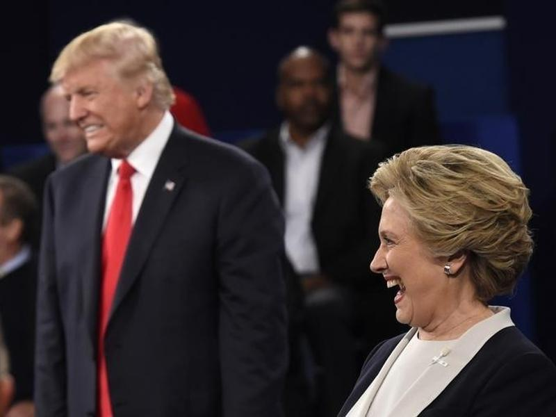 Republican US presidential nominee Donald Trump and Democrat presidential nominee Hillary Clinton react as an audience member asks the candidates to say what they admire about each other during their presidential town hall debate at Washington University in St. Louis, Missouri. (Reuters Photo)