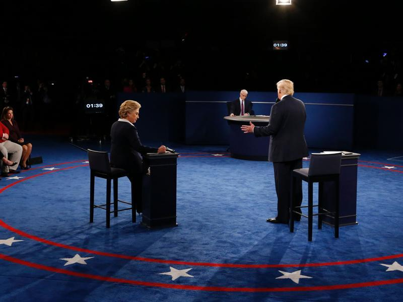 Donald Trump speaks as US Democratic presidential candidate Hillary Clinton (left) listens during the second presidential debate at Washington University. (AFP Photo)