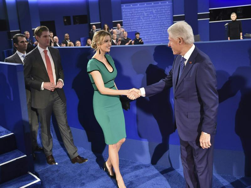 Former president Bill Clinton greets Ivanka Trump, daughter of Republican presidential candidate Donald Trump, followed by her brothers Eric Trump and Donald Trump Jr, before the start of the second presidential debate at Washington University. (AFP photo)