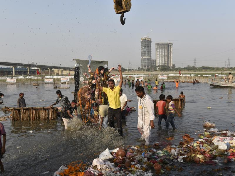On the occasion of Dussehra, the tenth day after Navratri, the idol of Goddess Durga is being immersed in the Yamuna in New Delhi.  (Saumya Khandelwal/HT PHOTO)