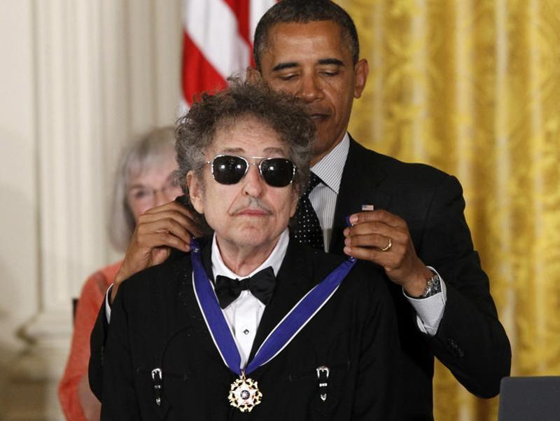 US President Barack Obama presents rock legend Bob Dylan with a Medal of Freedom during a ceremony at the White House in Washington. (AP Photo)