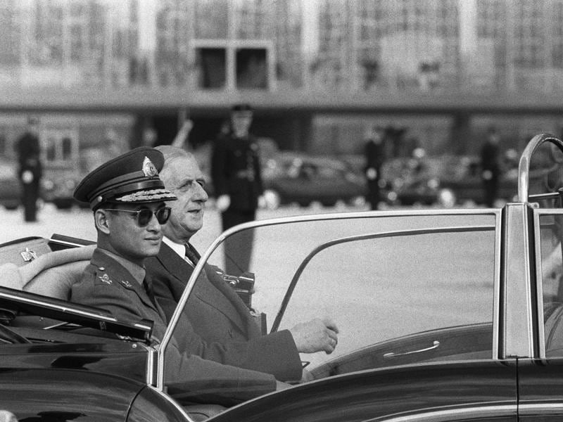 This file photo taken on October 11, 1960 shows Bhumibol Adulyadej (L) riding with French President Charles de Gaulle upon his arrival at Orly airport, south of Paris.  (AFP)