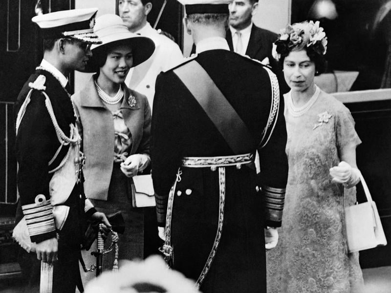 This file photo taken on July 1, 1960 shows Thai Queen Sirikit (2nd L) and King Bhumibol Adulyadej (L) being greeted by Britain's Queen Elizabeth II (R) and Prince Philip, Duke of Edinburgh, upon their arrival in London.  (AFP)