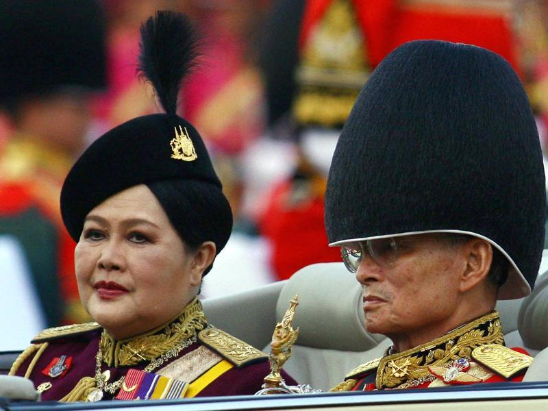 This file photo taken on December 2, 2006 shows Thai King Bhumibol Adulyadej (R) reviewing the honour guard next to Queen Sirikit as part of celebrations to commemorate his 79th birthday at the Royal Plaza in Bangkok.  (AFP)