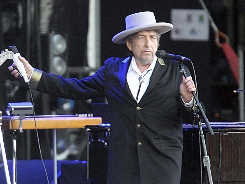 Bob Dylan performing onstage at Les Vieilles Charrues Festival in Carhaix, western France. (AP Photo)