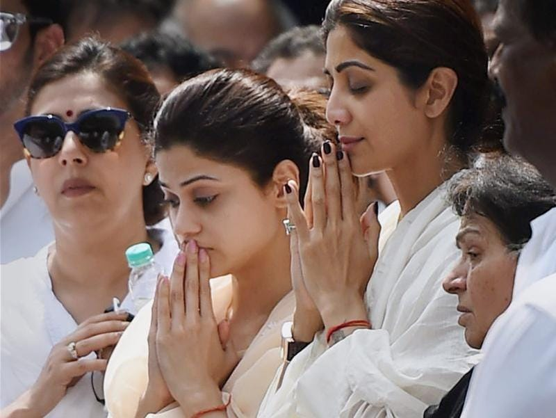 Bollywood actor Shilpa Shetty along with sister Shamita Shetty  during her father Surendra Shetty's funeral in Mumbai on Wednesday. (PTI Photo)
