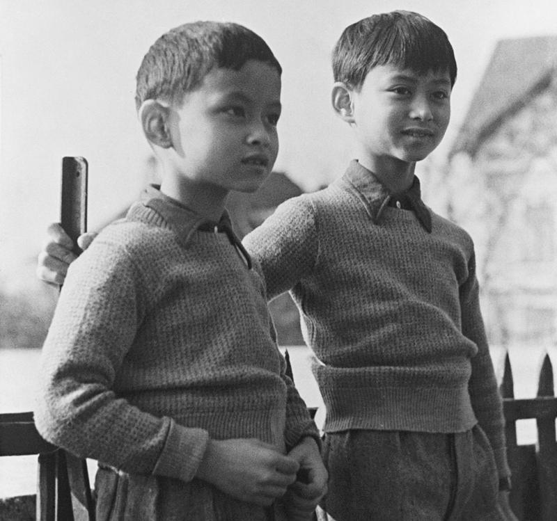In this March 7, 1935, file photo, Prince Bhumibol, left, stands with his brother, King Ananda Mahidol of Siam, now known as Thailand, at their school in Lausanne Switzerland. King Bhumibol was born in 1927 in Cambridge, Massachusetts, where his father, Prince Mahidol, was then studying medicine. (AP)